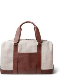 Бежевая дорожная сумка из плотной ткани