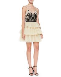 Бежевое коктейльное платье из фатина с украшением