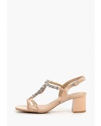 Бежевые кожаные босоножки на каблуке с украшением от Kylie