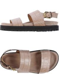Бежевые кожаные сандалии на плоской подошве
