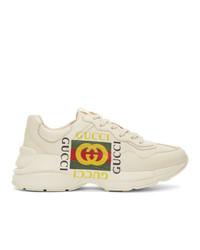 Мужские бежевые кроссовки с принтом от Gucci