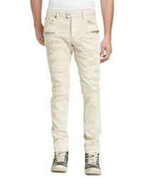 Бежевые рваные джинсы
