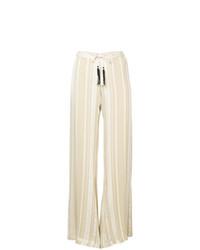 Бежевые широкие брюки от Zeus+Dione