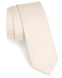 Бежевый галстук в клетку
