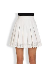 Белая короткая юбка-солнце с люверсами