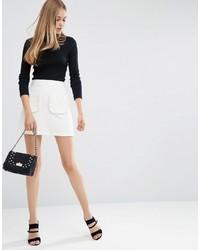Белая мини-юбка с рюшами