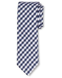 Бело-темно-синий галстук в мелкую клетку