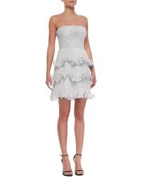 Бело-черное коктейльное платье в горошек