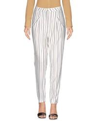 Бело-черные брюки-галифе в вертикальную полоску