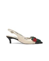 Бело-черные кожаные туфли от Gucci