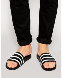 Бело-черные резиновые сандалии в горизонтальную полоску