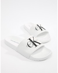 Мужские бело-черные резиновые сандалии от Calvin Klein