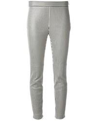Бело-черные узкие брюки в вертикальную полоску