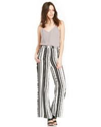 Бело-черные широкие брюки в вертикальную полоску