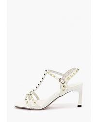 Белые кожаные босоножки на каблуке с шипами от Sprincway