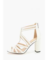 Белые кожаные босоножки на каблуке от Diora.rim