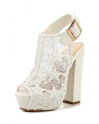 Женские белые кожаные босоножки на каблуке от Fiori&Spine