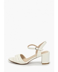 Белые кожаные босоножки на каблуке от T.Taccardi