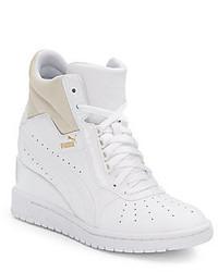 Белые кожаные кроссовки на танкетке