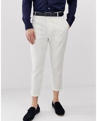 Белые льняные брюки чинос