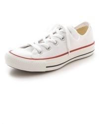 Женские белые низкие кеды из плотной ткани от Converse