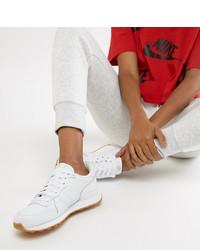 Женские белые низкие кеды от Nike