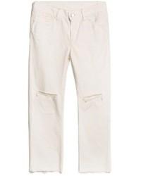 Белые рваные джинсы-бойфренды