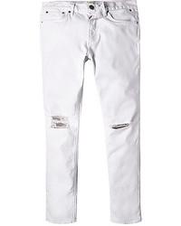 Белые рваные зауженные джинсы