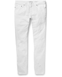 Мужские белые рваные зауженные джинсы от Saint Laurent