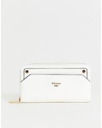 Белый кожаный клатч от Dune