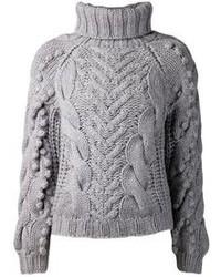 Для активного дня в компании друзей отлично подойдет сочетание топсайдеров и вязаного свитера.