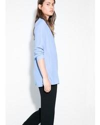 Голубая блузка с длинным рукавом
