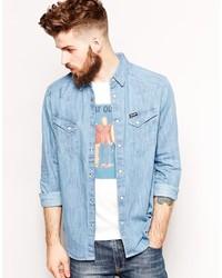 179903c0311 Купить мужскую голубую джинсовую рубашку Wrangler - модные модели ...
