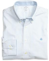 Голубая рубашка с длинным рукавом в вертикальную полоску