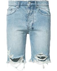 Голубые джинсовые рваные шорты