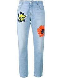 Голубые джинсы с вышивкой