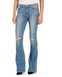 Голубые рваные джинсы-клеш