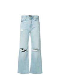 Голубые рваные джинсы-клеш от Simon Miller