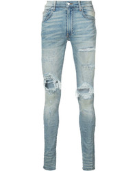 Голубые рваные зауженные джинсы