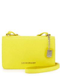 Желтая кожаная сумка через плечо