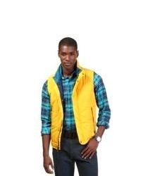 Желтая стеганая куртка без рукавов
