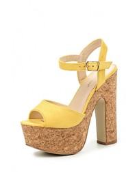 Женские желтые босоножки на каблуке от Ideal