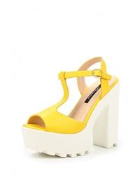 Женские желтые кожаные босоножки на каблуке от Fersini
