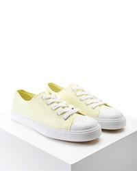 Желтые низкие кеды из плотной ткани
