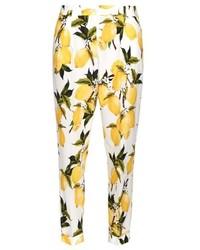 Желтые узкие брюки с принтом