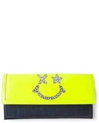 Желтый кожаный клатч с украшением