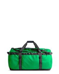Зеленая дорожная сумка из плотной ткани