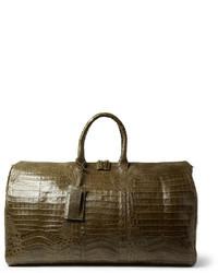 Зеленая кожаная дорожная сумка