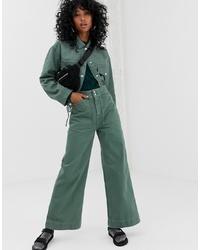 Зеленые джинсы-клеш