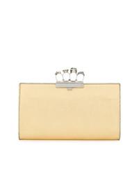 Золотой кожаный клатч от Alexander McQueen